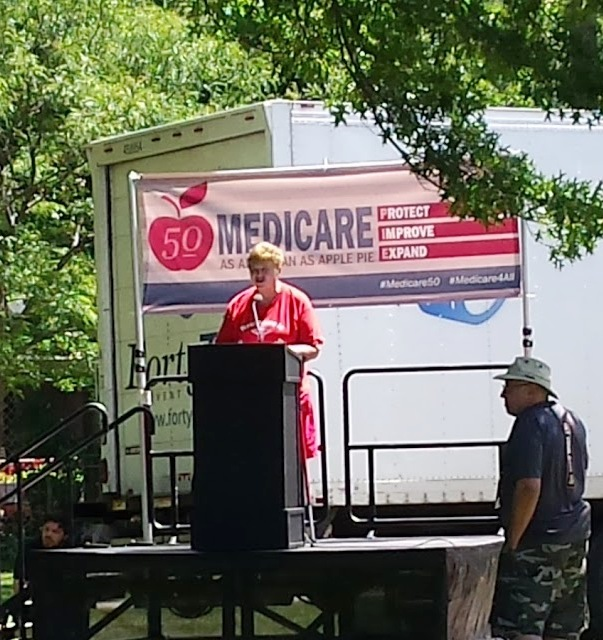 SPAN State Director Debbie (not Becky) Silverstein speaks at Lakewood Park rally celebrating Medicare's 50th anniversary and calling for saving Lakewood Hospital